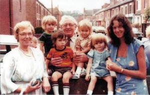 When we returned to England at the end of our first year.  With my mum and dad (Nancy & Mev), and I'm holding my Goddaughter, Kelly.